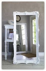 leaning white baroque mirror large