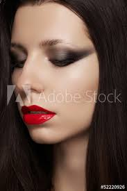 model with glamour red lips make up