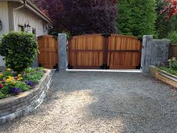 Matching Driveway And Walk Through Gates Can Add Beauty Privacy And Functionality To Your Space Cedar Wood Gates Driveway Gate Backyard Gates Yard Remodel