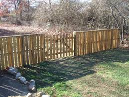 A Fence Alternative That Could Save You Some Money And Time Diy Pallet Upcycle Pallet Fence Wood Pallet Fence Fences Alternative