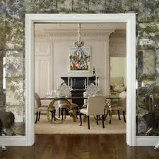 a wall of antiqued mirror panels as