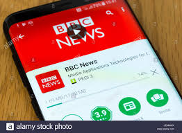 A closeup on the BBC News app being downloaded on a smartphone Stock Photo  - Alamy