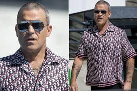 Coronavirus: Robbie Williams axes one-off Australian gig after ...