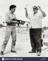 """Elvis Presley with his manager, Colonel Tom Parker, on the set of """"Follow  That Dream"""" (1962) United Artists File Reference # 33848-239THA Stock Photo  - Alamy"""