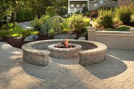 custom brick patio with fire pit and
