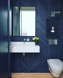 Herringbone tile bathroom by Aahed Abdullah on Lobby | Small bathroom  makeover, Powder room tile
