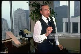 Risk arbitrageur Ivan Boesky working phones in office. | Office, Risk, Phone