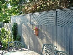 Extending A Privacy Fence With Wood Lattice Screen Panels Privacy Fence Landscaping Backyard Fences Privacy Fence Designs