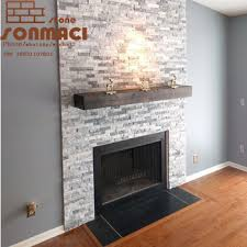 stacked grey marble stone fireplace
