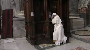 Pope Francis kneels before a priest to confess in St. Peter's ...