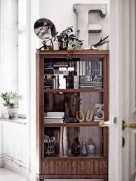 how to decorate your glass cabinets in