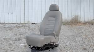 remove a front seat from a ford explorer
