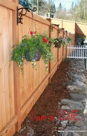 Hanging Flower Pots On Fence Posts Privacy Fence Landscaping Fence Landscaping Backyard Landscaping
