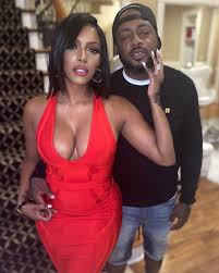 RHOA's Porsha Williams busts out of red dress while posing with fiancé  Dennis McKinley after protesting for BLM
