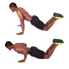 Shirtless Muscular Man Demonstrates How To Perform Knee Push Ups - High Quality Free Stock Images