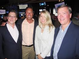 Attending the Shaw Charity Classic opening night festivities held at Flames  Central on Aug. 26 are