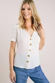Abby White V-Neck Button Top... - Morning Lavender | Facebook