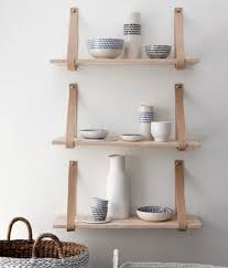 wood shelves with leather straps mad