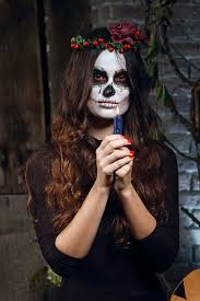 sugar skull makeup holding candle