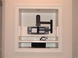 tv niche above the fireplace