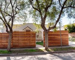 Tall Wood Fence In Front Of House Fence Design Front Yard Fence Wood Fence