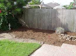 Raised Garden Bed Against Wood Fence Garden Design Ideas