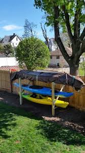 Our Canoe Kayak Rack To Existing Fence Always On The North Side Of Your South Fence When Possible Keep It Simple U Kayak Storage Kayak Storage Rack Kayaking