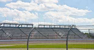 An Automobile Racetrack Between A Fence And Stands Stock Photo Picture And Royalty Free Image Image 8079686