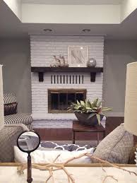 painted brick fireplace wood mantle and