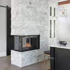 marble double sided kitchen fireplace