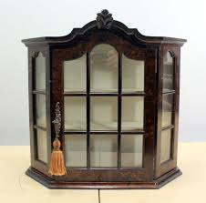 a wall display cabinet glass wood