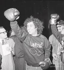 Abbie Hoffman And Friend Talk To Press by Bettmann