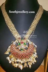 pearl strings with chandramukhi pendant
