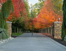 Swinging Right Into Fall With This Double Swing Gate Gates Fall Custom Driveway Driveway Entrance Landscaping Farm Gate Entrance Iron Gates Driveway