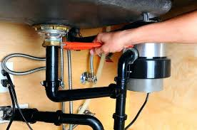 fixing a leaky pipe under bathroom sink