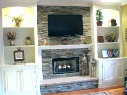 pictures of tv over fireplace