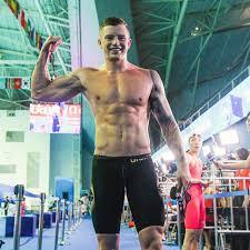 Adam Peaty breaks own record to win 100m breaststroke gold