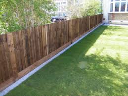 To Prevent Digging Along The Fence Wood Fence Paver Border Backyard Fences Backyard Backyard Landscaping Designs
