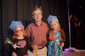 Braden River Elementary students have a ball - Keither Wrightmour finds two  princesses, his nieces Emma and Abby Burns.   Your Observer