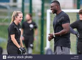 Efe Obada (right) shares a joke with a student during the Stock Photo -  Alamy