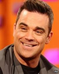 Robbie Williams returns to number one spot - BBC News