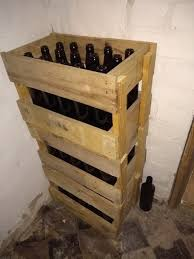 brown beer bottles in homemade crates