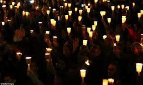 Image result for many holding candle in the dark