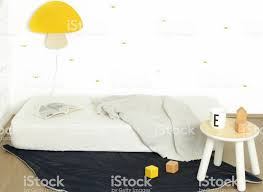 Simple Kids Bedroom Interior With A White Mattress On The Floor And Yellow Mushroom Lamp On The Wall Stock Photo Download Image Now Istock