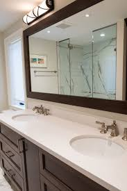 dark wood framed bathroom mirror built