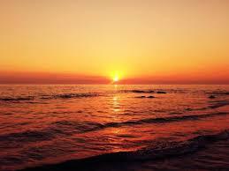 sunset beach sun water sky