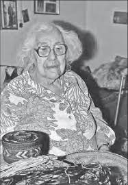 Minnie Johnson with baskets in her home, Angoon, October 1983 ...