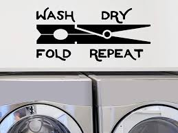 Amazon Com Story Of Home Llc Wash Dry Fold Repeat Laundry Room Decal Clothespin Laundry Vinyl Wall Decal Home Kitchen