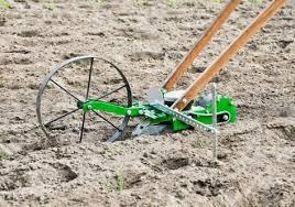 wheel hoe seeder attachment combo