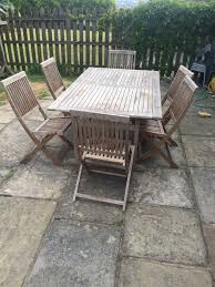 solid teak garden table and 6 chairs